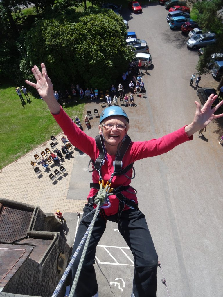 Happy participant abseiling