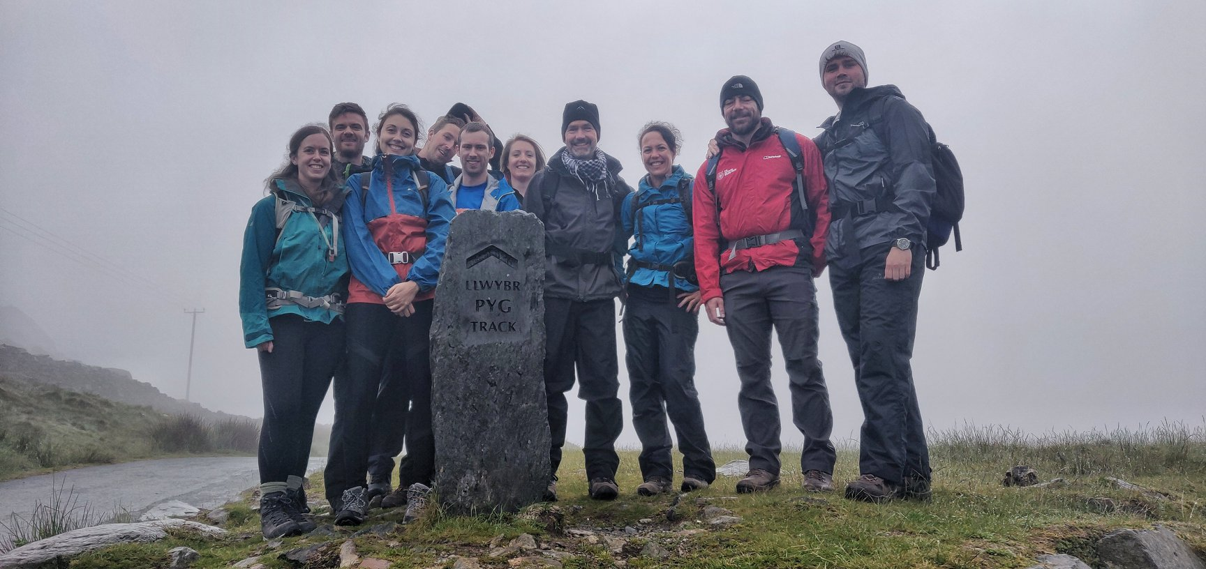 A 3 national 3 peaks group heading up to Snowdon summit