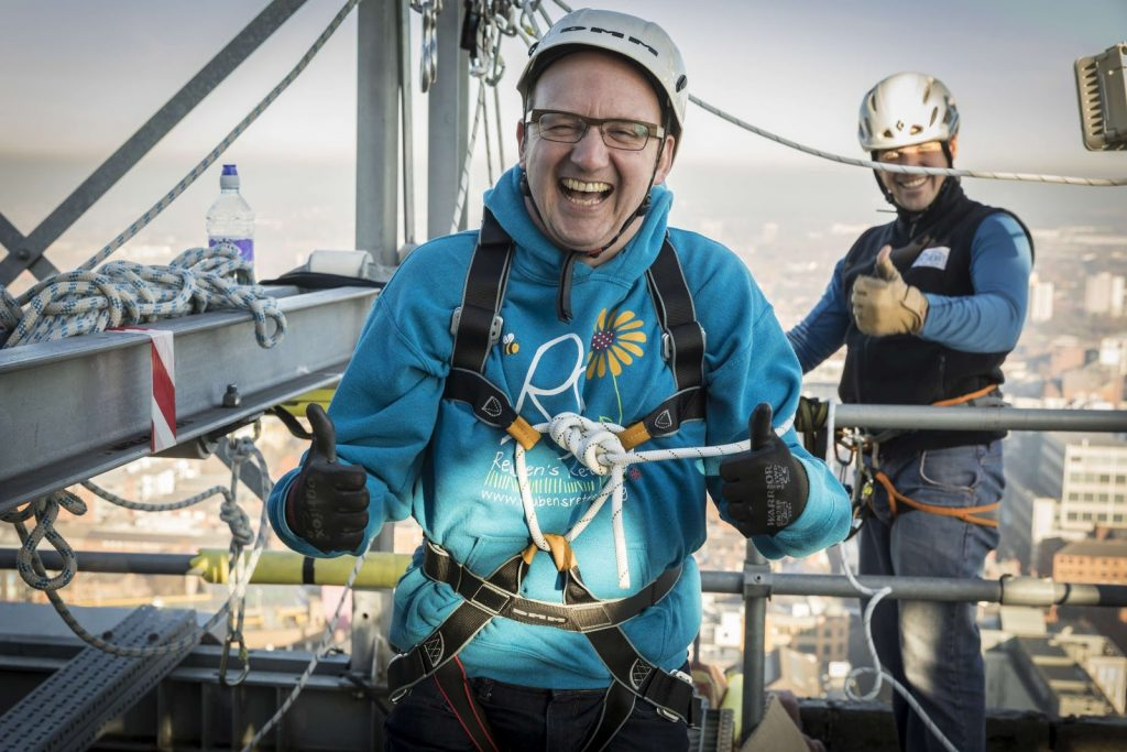 Happy participant abseiling in Manchester